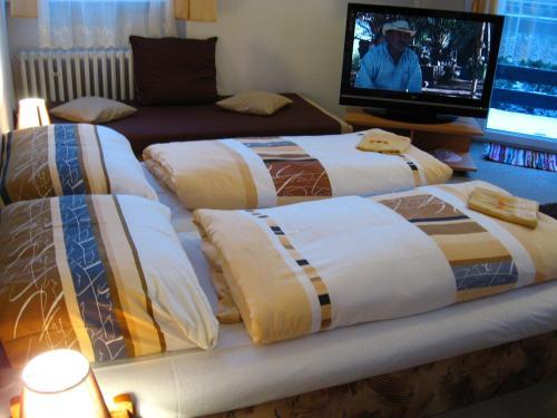 A bed or beds in a room at Penzión Slávia