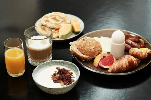 Breakfast options available to guests at Hotel Opus Horsens