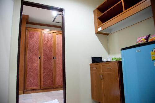 A kitchen or kitchenette at AmornSukhothai Hotel