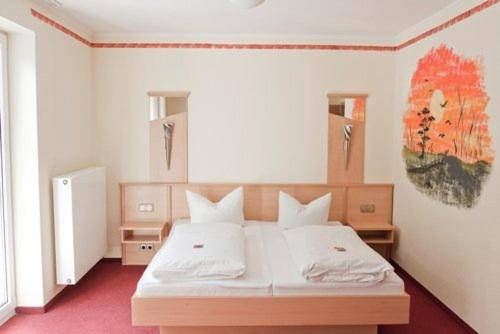 A bed or beds in a room at Hotel Haus am Stein