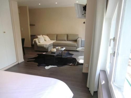A bed or beds in a room at Les Carmes