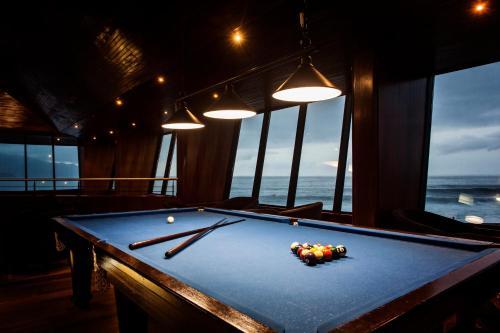 A pool table at Estalagem do Mar
