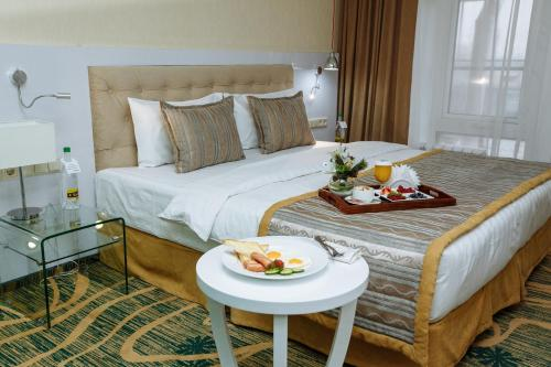 A bed or beds in a room at Hotel Kazzhol Almaty