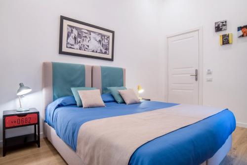 Letto o letti in una camera di Napoliamo Guest House