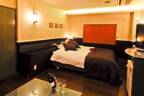 ホテル ポシェット (大人専用)にあるベッド