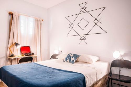 A bed or beds in a room at Selina Santa Teresa North