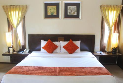 A bed or beds in a room at Gardenia Resort and Spa
