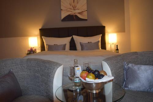 Ein Bett oder Betten in einem Zimmer der Unterkunft Landhotel Zum Kronprinzen