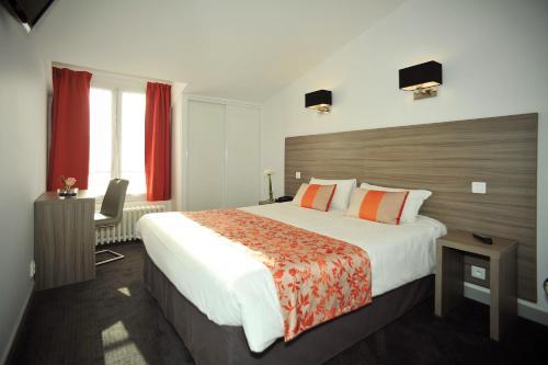 Un ou plusieurs lits dans un hébergement de l'établissement Hôtel Atlantic