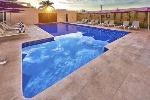 The swimming pool at or near City Express Plus Puerto Vallarta