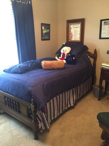A bed or beds in a room at Bordelon's LA Home Cooking & Decor