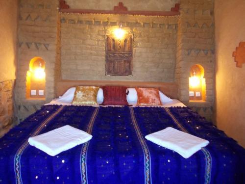 Cama o camas de una habitación en Kasbah Azalay Merzouga