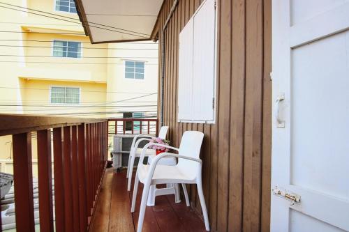 A balcony or terrace at Hua Hin Lubsabai Hostel