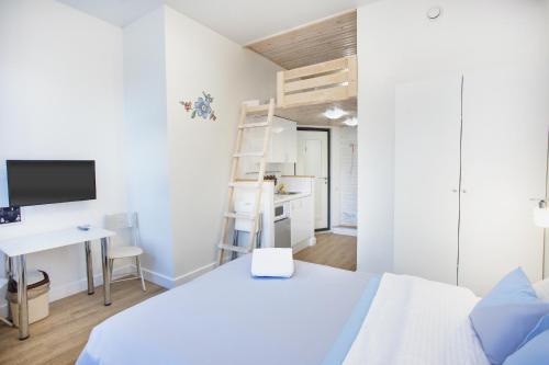 Кровать или кровати в номере БРИКК