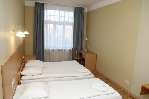 Posteľ alebo postele v izbe v ubytovaní Guesthouse Jakob Lenz