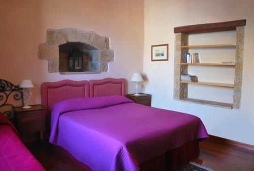 Letto o letti in una camera di La Magnolia