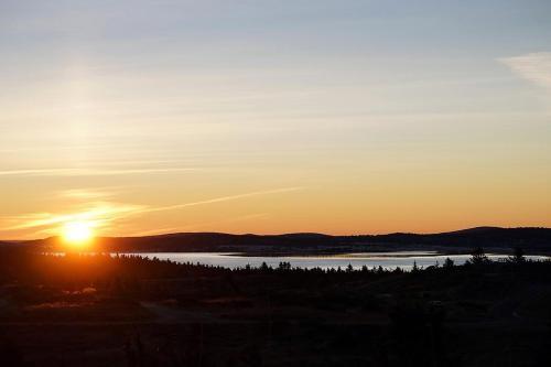 Soloppgangen eller solnedgangen sett fra hotellet eller i nærheten