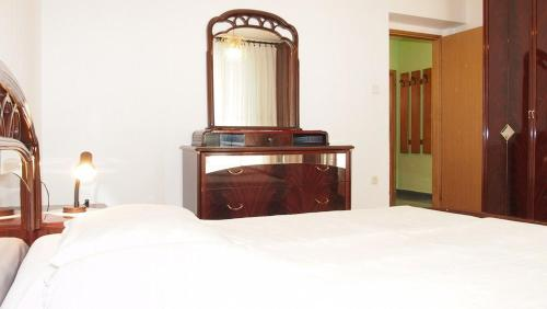 A bed or beds in a room at Family Apartments Marita