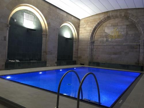 The swimming pool at or near Abbey Garden at the Highland Club