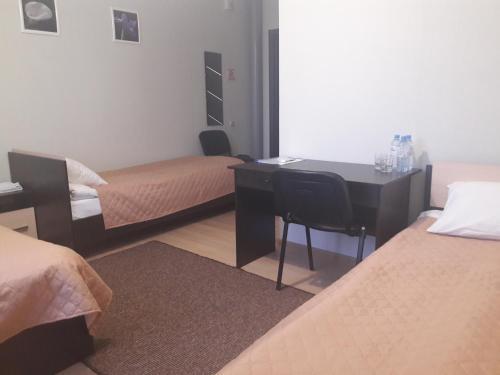 Кровать или кровати в номере Гостевой дом Брусника
