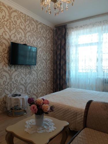Кровать или кровати в номере Apartment on Pyatigorskaya 24/1