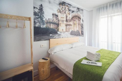 A bed or beds in a room at Casual Serantes