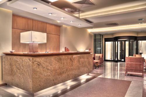 El vestíbulo o zona de recepción de Hotel Calypso
