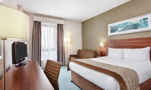A bed or beds in a room at Jurys Inn Milton Keynes