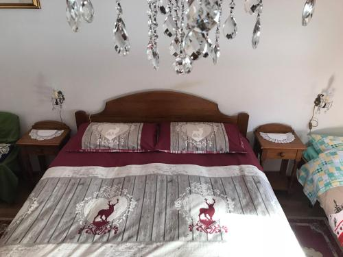 A bed or beds in a room at Affittacamere I Ragi d'Or