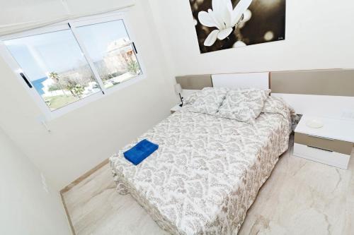 Ein Bett oder Betten in einem Zimmer der Unterkunft Apartamentos Almadraba VyB