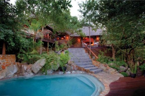 The swimming pool at or near Leopard Hills Private Game Reserve