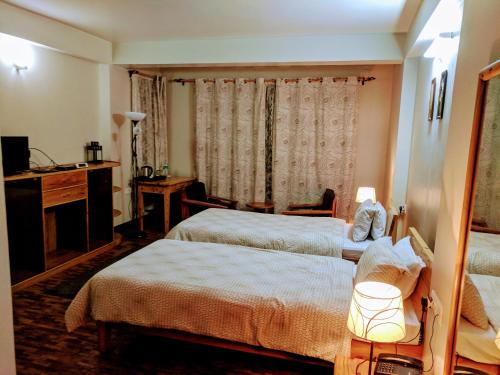 A bed or beds in a room at Yuru Retreat Delo