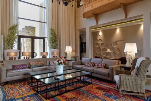 Coin salon dans l'établissement Château Roslane Boutique hôtel & Spa
