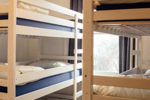 A bunk bed or bunk beds in a room at Brighton Youthful Hostel.....by the Sea