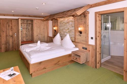 Ein Bett oder Betten in einem Zimmer der Unterkunft Hotel Wender