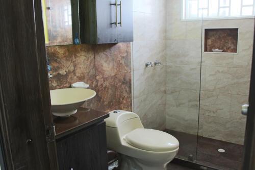 Um banheiro em Hospedaje Solymar Sarie Bay