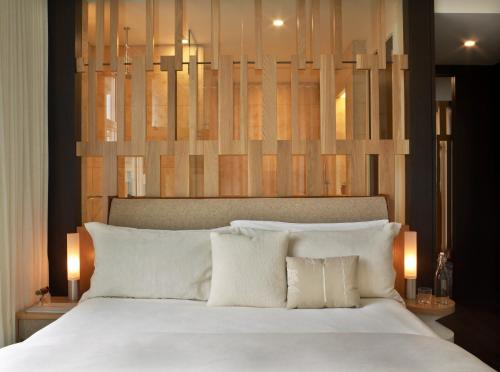 A bed or beds in a room at WestHouse Hotel New York