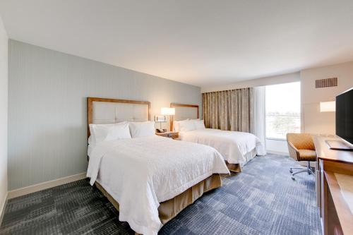 A bed or beds in a room at Hampton Inn & Suites North Houston Spring