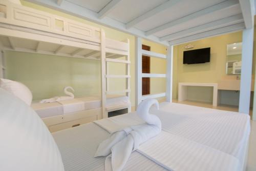 A bed or beds in a room at Shore Time Dormitel