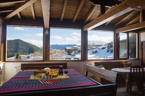 Ресторант или друго място за хранене в Къща за Гости Панорама