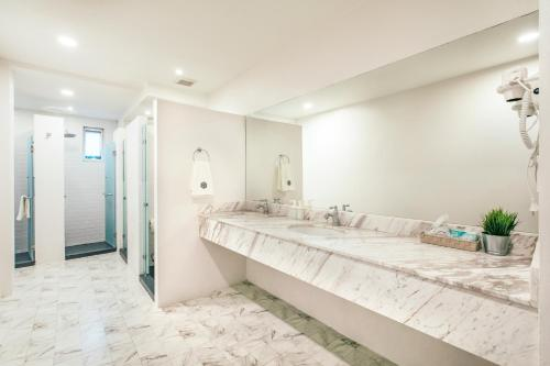 A bed or beds in a room at Chamberlain Boutique House - Silom