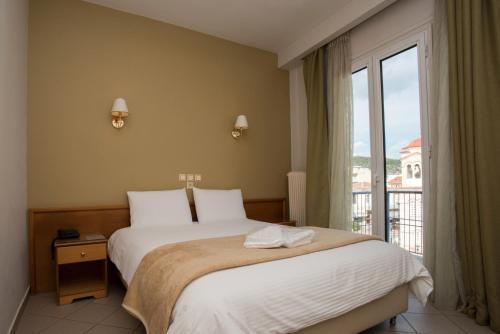 Ένα ή περισσότερα κρεβάτια σε δωμάτιο στο Ξενοδοχείο Μορφέας