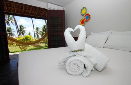 A bed or beds in a room at Bitingui Praia Hotel