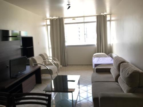 A seating area at Apartamento Tambaú