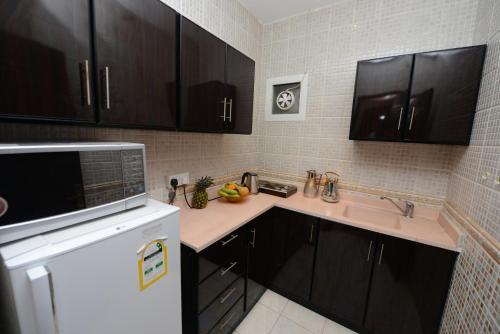 A cozinha ou cozinha compacta de Hotelier Al Sulaymaniyh