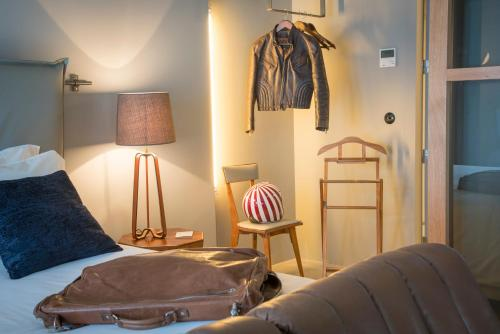 Cama o camas de una habitación en Raw Culture Art & Lofts Bairro Alto