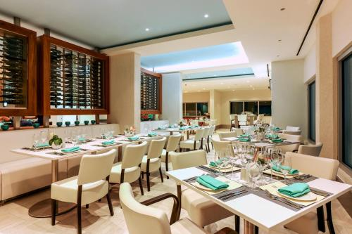 A restaurant or other place to eat at Harbor Club St Lucia, Curio Collection by Hilton