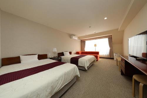 A bed or beds in a room at Hotel 21