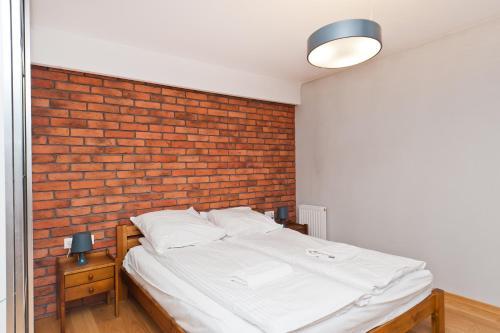 Łóżko lub łóżka w pokoju w obiekcie Apartamenty Sun & Snow Olimp Apartments