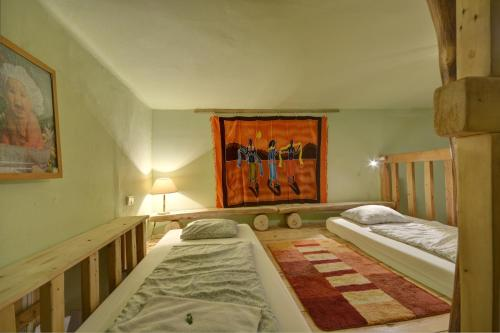 A bed or beds in a room at Artharmony Pension & Hostel